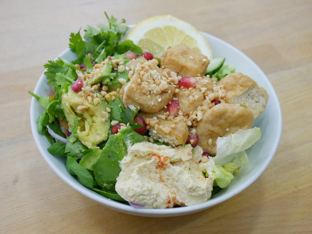 Naked Salad with the Sesame Garlic Tofu topped with plain hummus, crushed peanuts and pomegranates