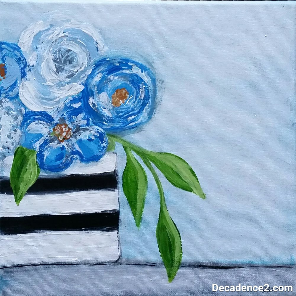 blue flowers in stripey vase.