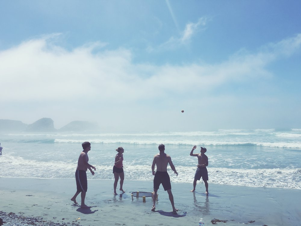 A picture-perfect game of Spikeball in the sand
