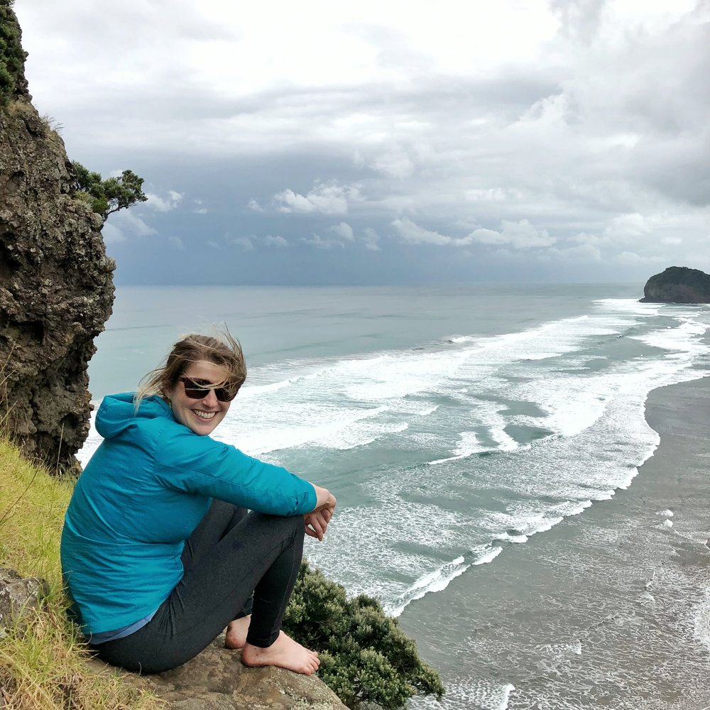 Katrina at the top of the Piha beach seastack