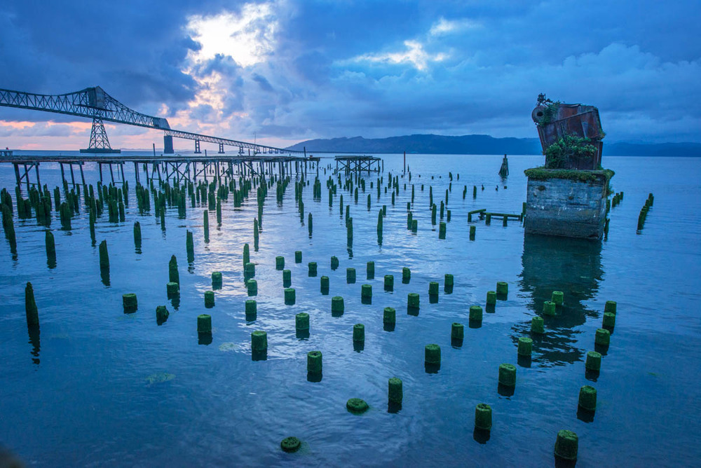 Last Light, Astoria ©Lynne Buchanan The algae-covered pilings created interesting patterns in the water.