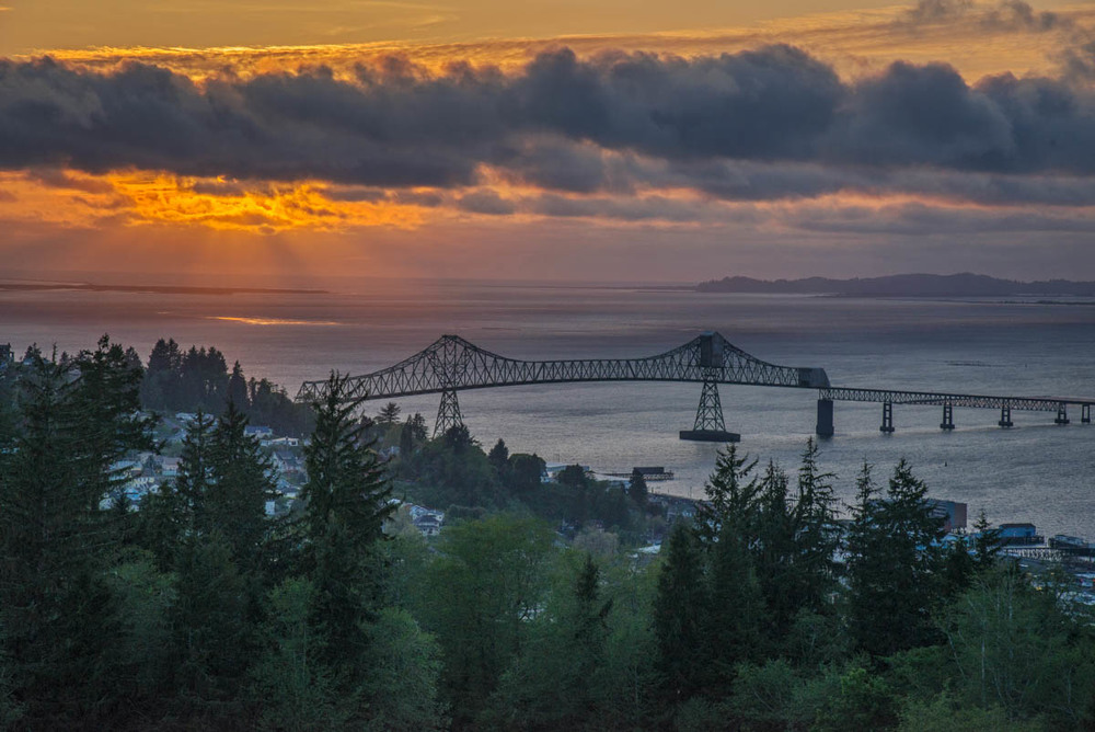 God Rays Beyond the Astoria–Megler Bridge ©Lynne Buchanan The evening ended with God Rays peeking out from under the clouds, just to be sure we realized how fortunate we'd been to have such good weather and beautiful vistas in the Pacific Northwest.