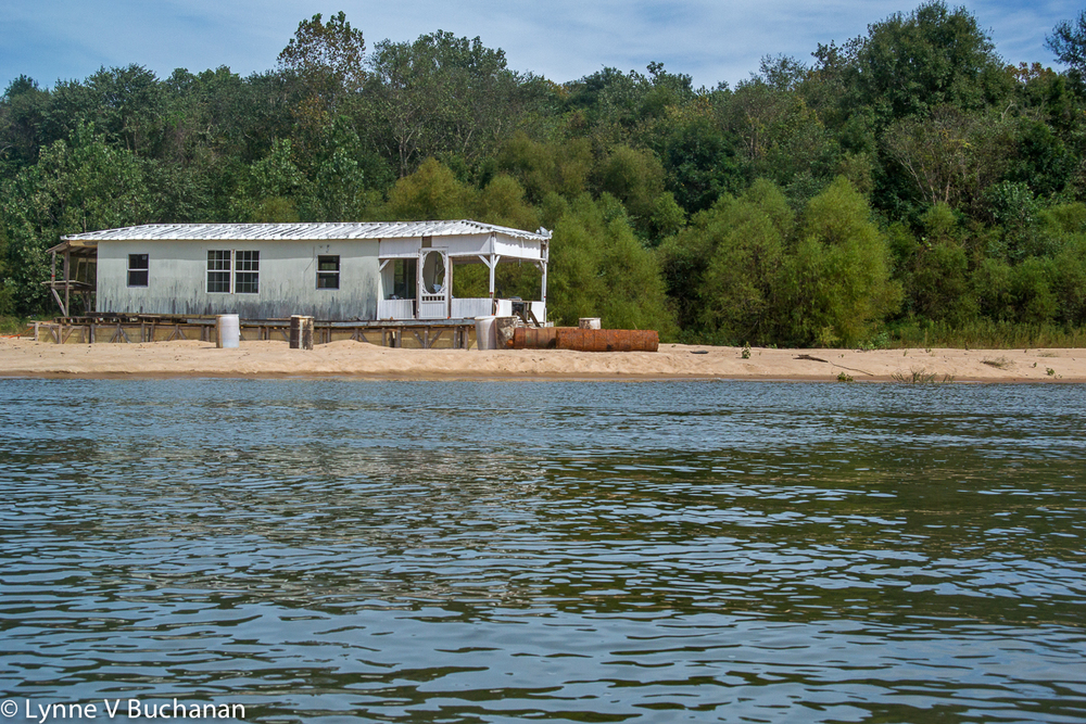 Beached White Floating House, Apalachicola River