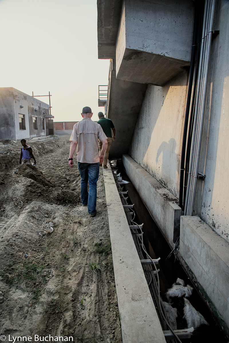 Sharif, Adrian, and a Worker Walking Through the Unfinished Effluent Treatment Plant