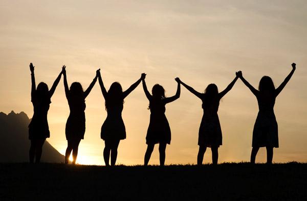 women raised arms silhouette