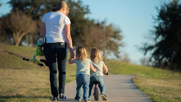 single mom and twins walking path