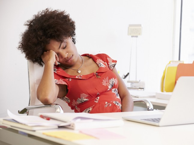 tired woman behind a desk