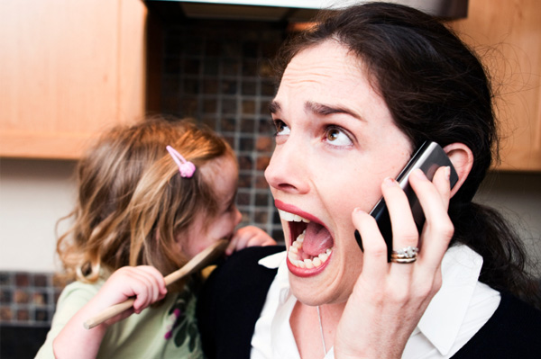 stressed mom on the phone