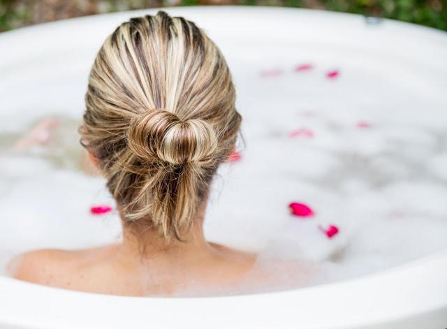 woman bathing in a hut tub
