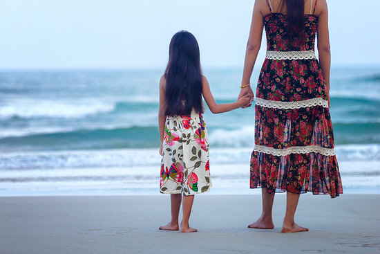 mom and daughter by the beach