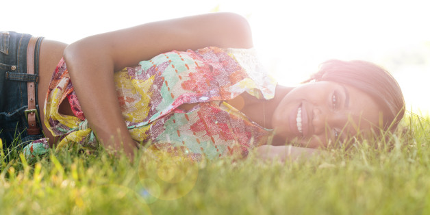 happy woman lying on the grass