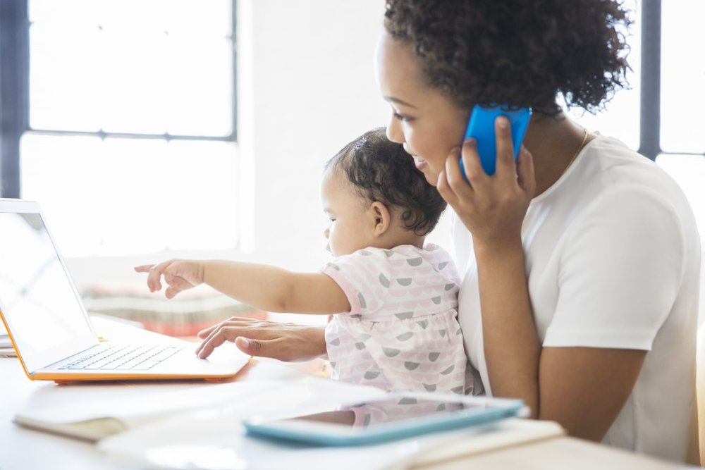 working mother with a baby