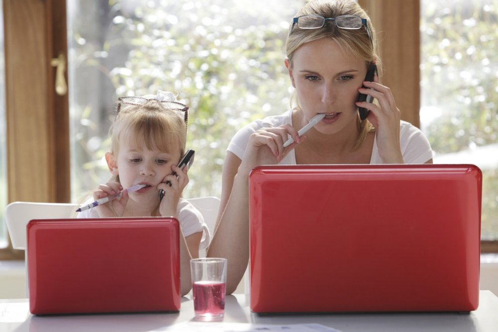 mother and daughter working