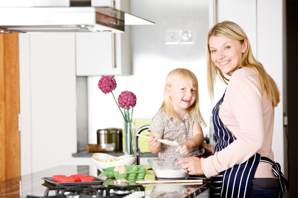 happy mother and daughter kitchen