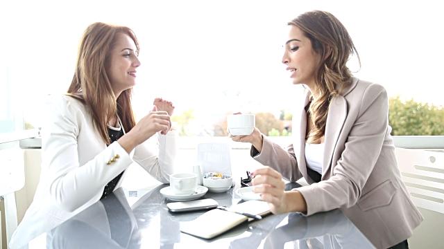 talking women over coffee