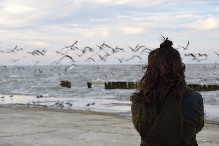 woman looking out to the sea