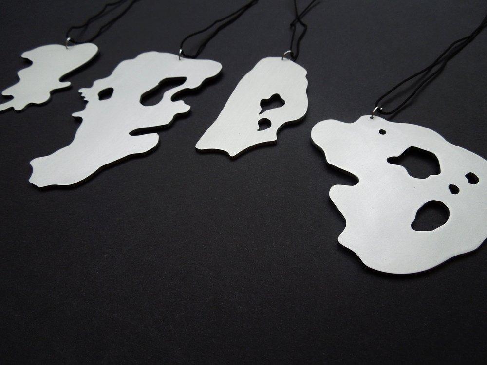 Vestiges 1, 2, 3, 4(L-R) 2012 Anodised aluminium, silk cord