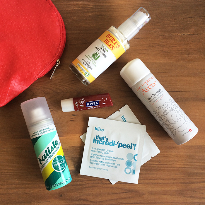 Clockwise:    (1) Burt's BeesNatural Acne Solutions Daily Moisturizing Lotion, (2) Avene Eau Thermale, (3) Bliss That's Incredi-'peel'! Glycolic Resurfacing Pads, (4) Batiste Dry Shampoo In 'Original', and (5) Nivea Fruity Shine Lip Care