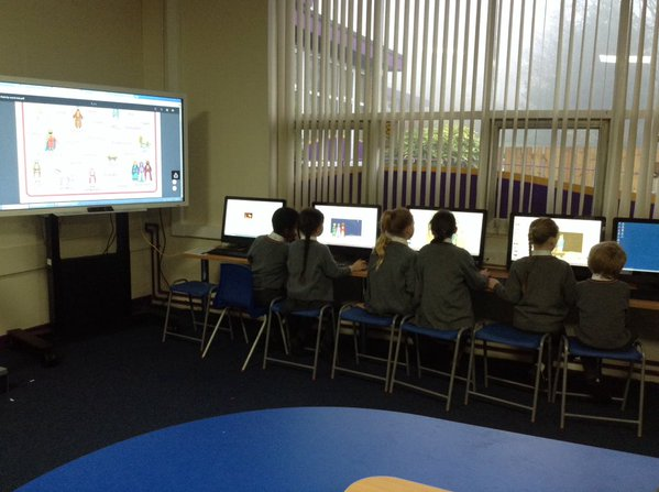 Year 2 creating a PowerPoint to retell the story of Jesus' birth in the Media Suite.
