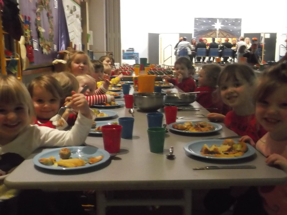 Nursery FS1 enjoying their Christmas Dinner