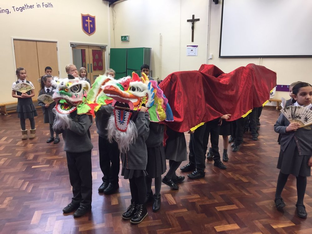 Photo: Holy Name Year 3 taking part in a Lion and Dragon dance workshop