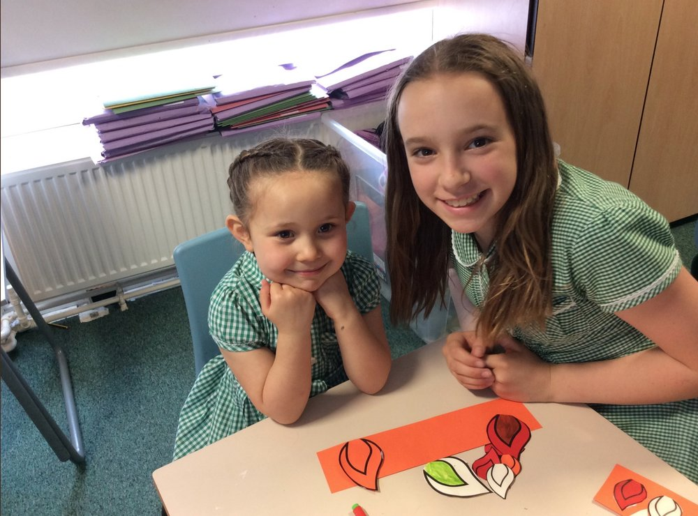 Photo: St Joseph' Otley Year 6 spending times with their buddies in Reception class preparing for Pentecost Celebration Day on May 18, 2018
