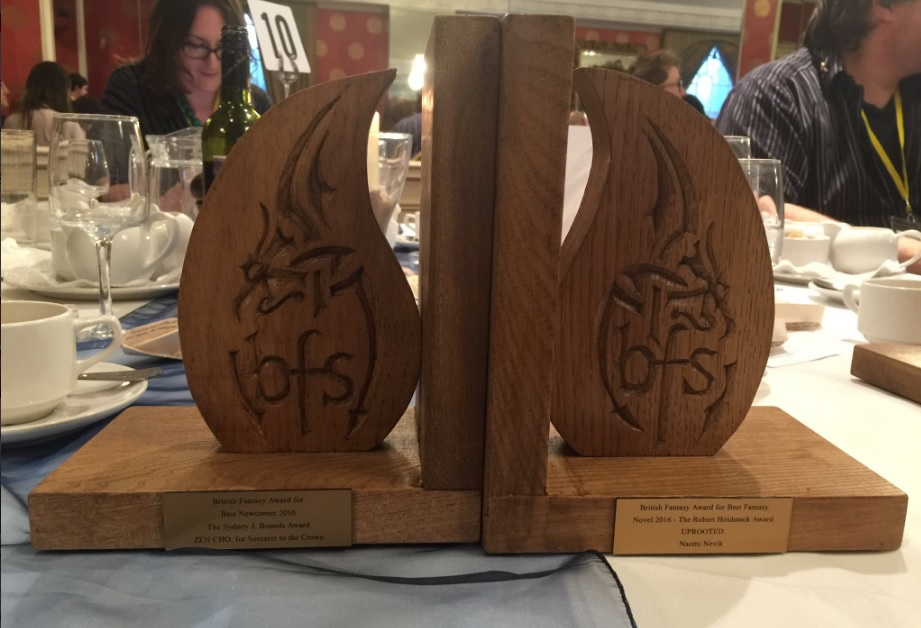 Appropriately bookend-shaped awards for Zen and Naomi! If you look carefully you can spot a Tor editor lurking in the background...