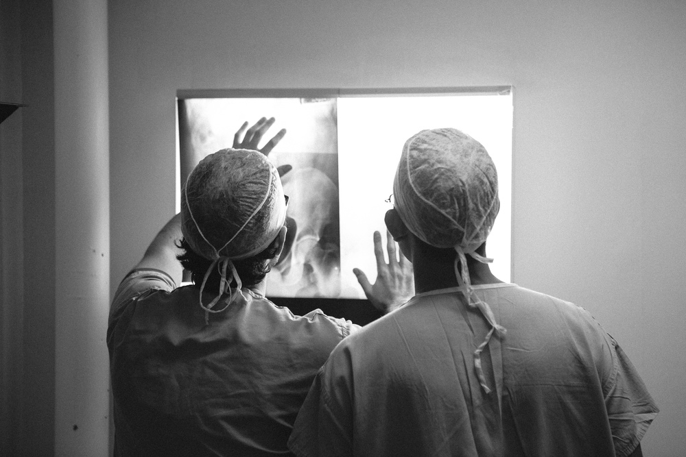Doctors International surgeons examine X-ray scans before surgery.