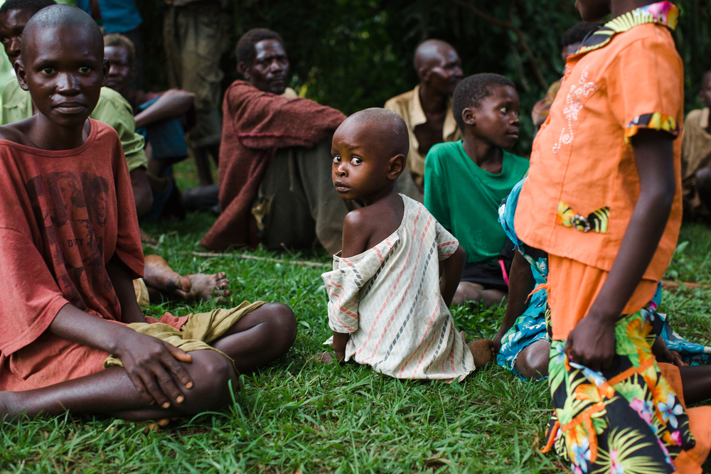 Patients with severe jigger wounds wait to be checked into a week long medical clinic at the Sole Hope compound.