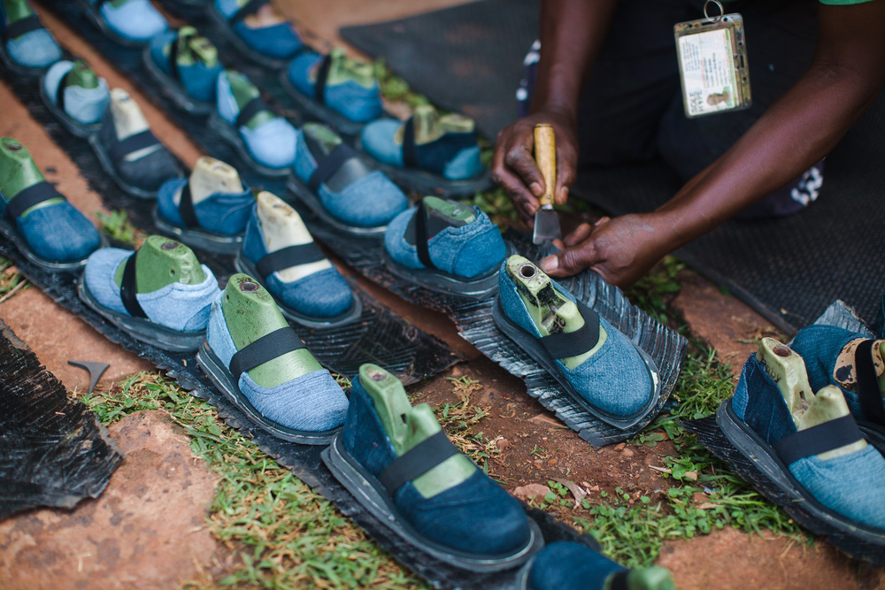 Sole Hope shoemakers cut soles out of locally sourced tires.