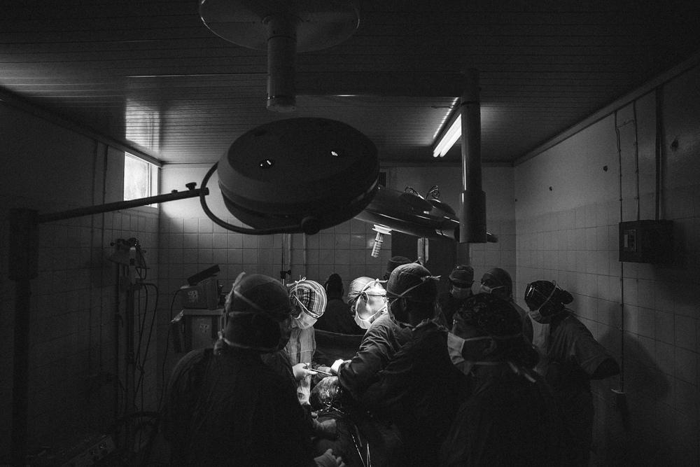 A Doctors International surgical team performs surgery alongside the West Demerara Hospital staff.