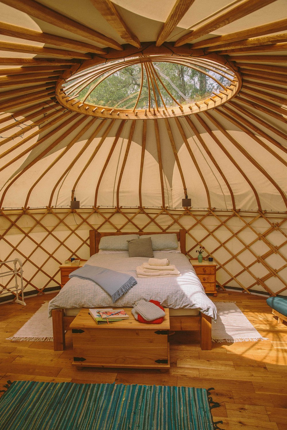 Inside Oak Tree Yurt with a sumptuous king size bed and yurt skylight