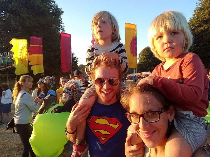 Festival fun with kids - although the boys seem too engaged in what they're watching to smile!