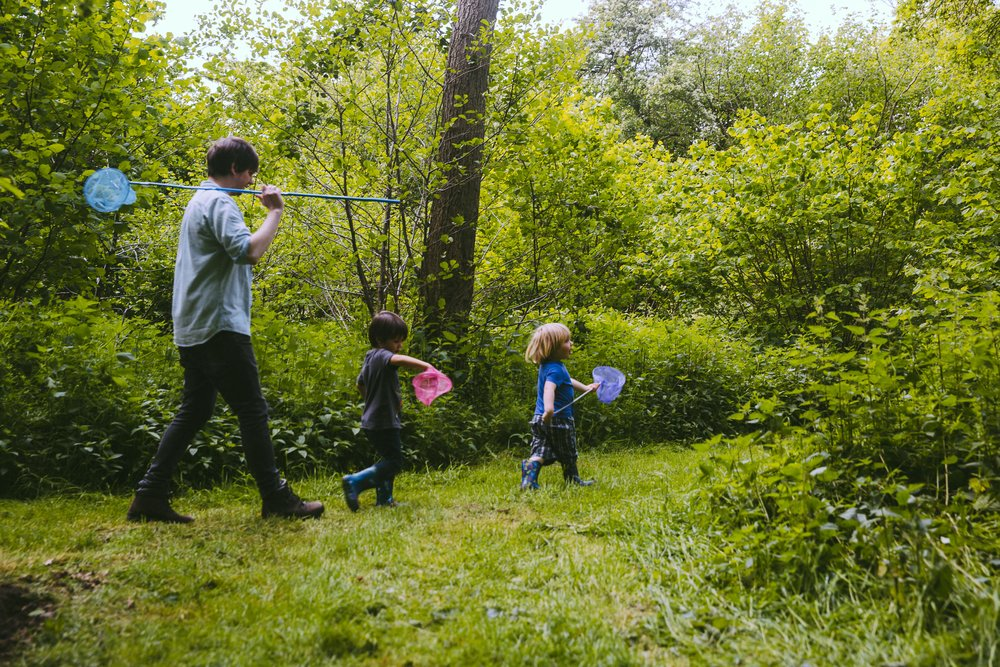Family exploring the woods on holiday