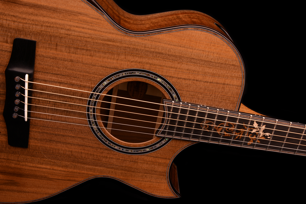 Walnut/Sinker Redwood Mid-Depth SJ; African Blackwood Binding; Walnut Top & Fingerboard Trim; African Blackwood/Abalone Rosette; Weyman Vine Fingerboard Inlay (Maple/Koa/Walnut/Mahogany); Ebony Bridge with Custom Walnut Dots in Bridgepins.