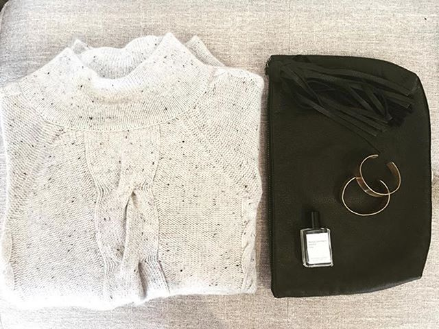 Regram via @alchemyhour Fringe clutch ✔️ stacked bracelets ✔️ perfect cozy speckled cashmere mock neck sweater ✔️ perfume oil ✔️ obviously worn with your favorite @raleighdenimworkshop black jeans ✔️ this is what Sunday's are made of. #ootd #wiwt #blackandwhite #monochrome #warm