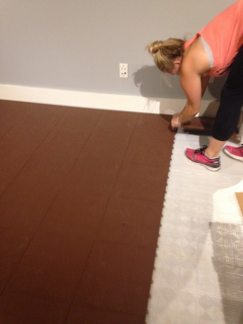 Kate ripping up the ugly brown flooring.