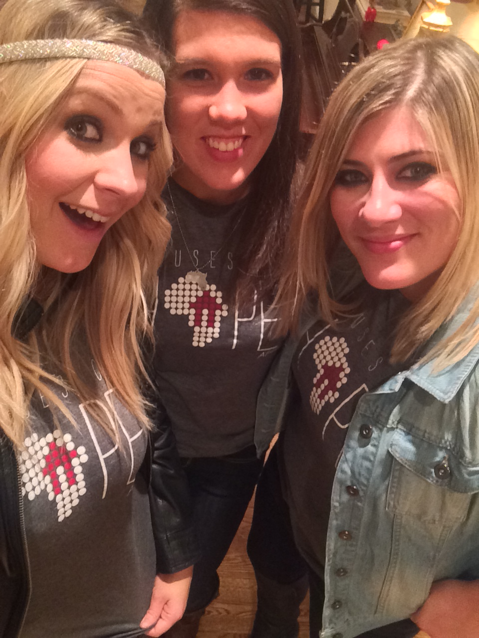 3 girls in Houses of Hope Africa t-shirts. Abby, always showing up. So great. Love her.