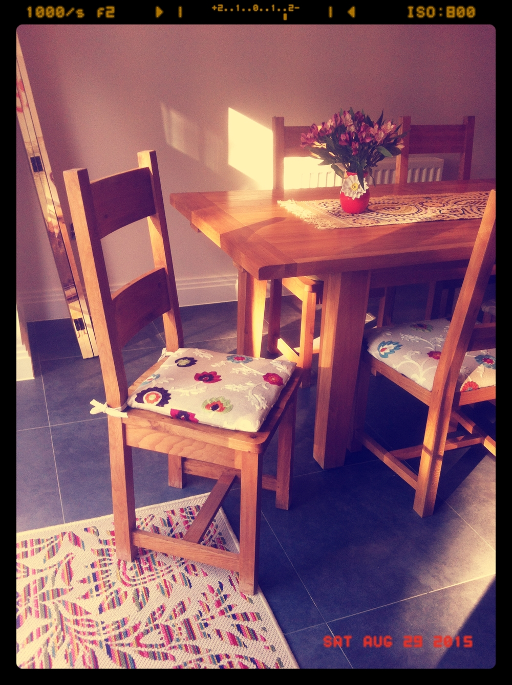 The lovely seat cushions in situ with the sun streaming through the window makes for a perfect photo!