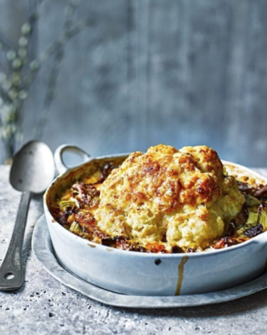 Whole Baked Cauliflower with With Pearl Barley, Wild Mushrooms, and Cheese -