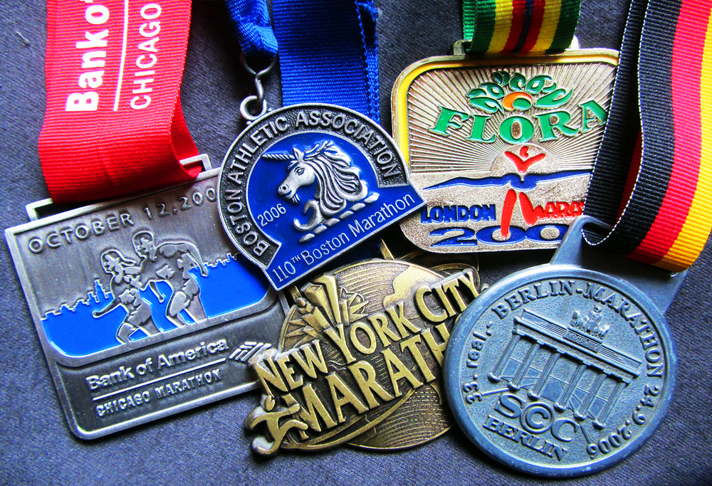 "By the way, I ran the         World Marathon Majors -  "" The Marathon Grand Slam"""