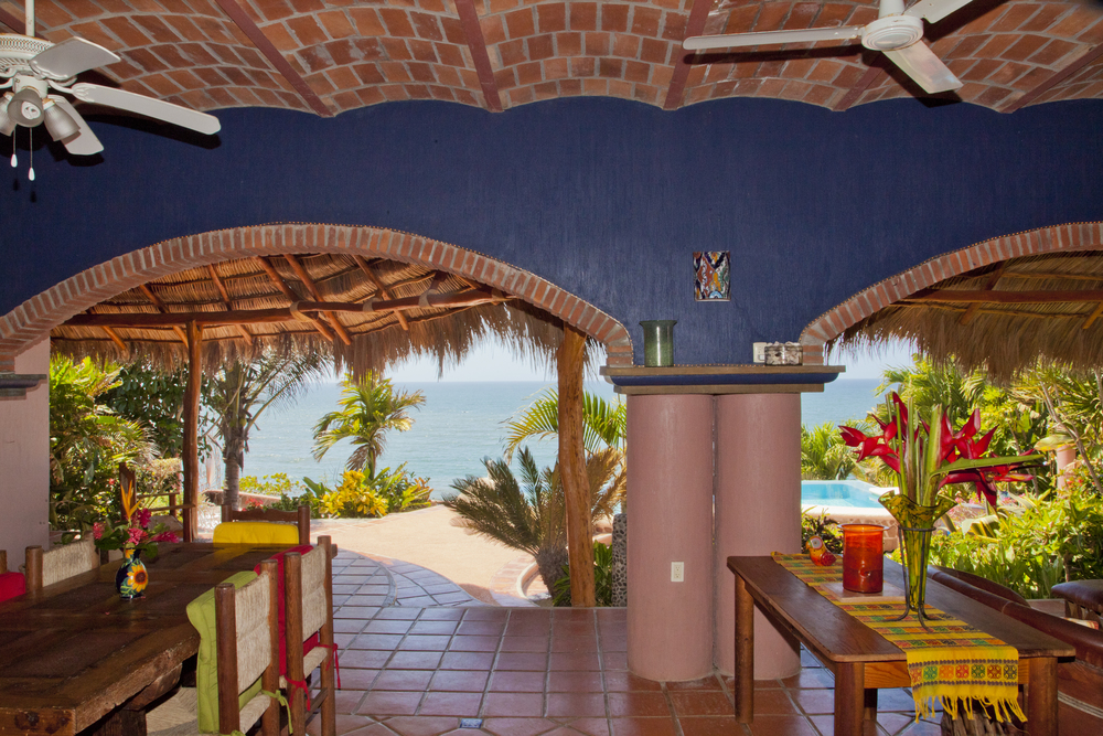 When you step outside for the first time, this is the view that will convince you that you are in paradise.  The table on the left is the central meeting space for meals, computer work, snacks and table games day or night.  With lots of overhead fans and an almost constant ocean breeze make this area the natural gathering spot during your stay.