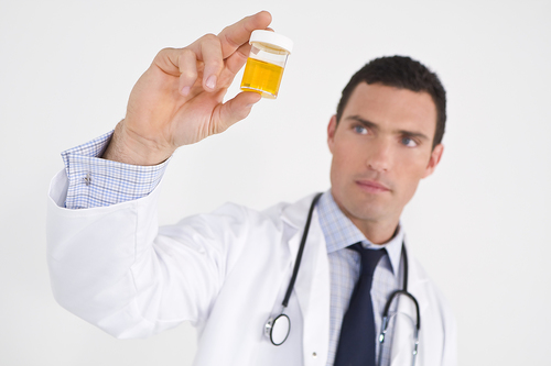 bigstock-Concerned-Doctor-With-Sample-5032694.jpg