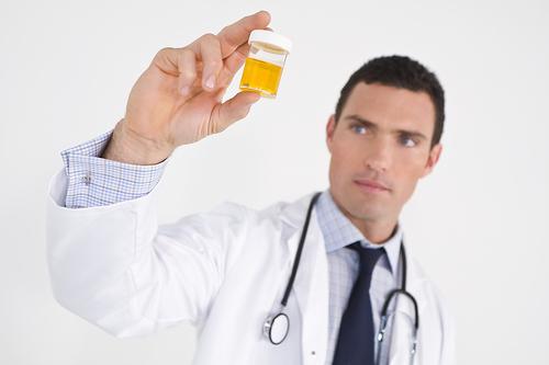 bigstock-Concerned-Doctor-With-Sample-5032694.jpg
