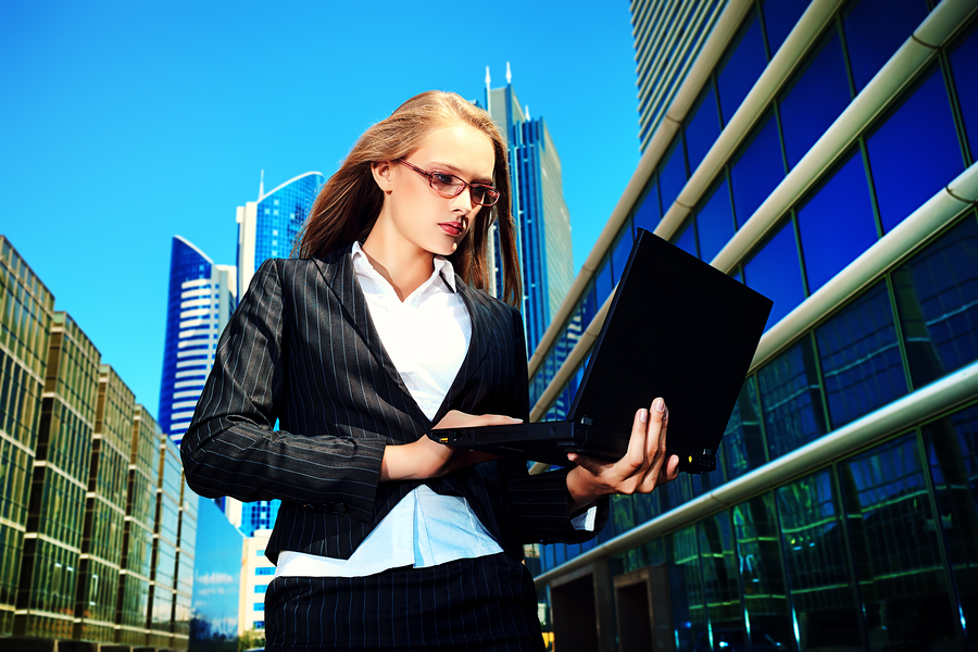 bigstock-Young-business-woman-standing--45687961.jpg
