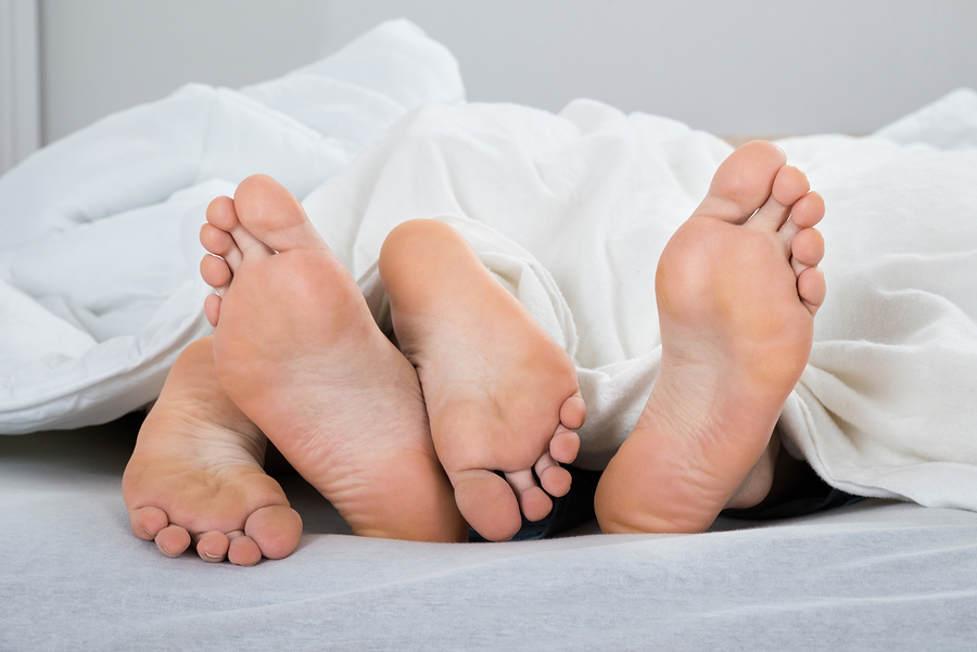 bigstock-Feet-Of-Couple-In-Bed-89422334.jpg