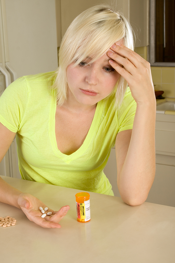 bigstock-Young-Blond-Woman-With-Medicin-12068330.jpg