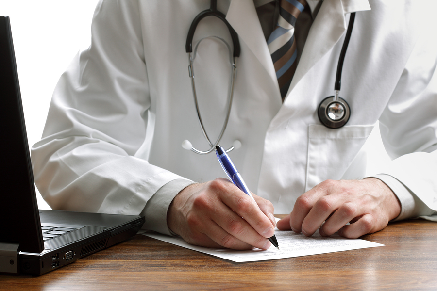 bigstock-Doctor-writing-patient-notes-o-16554509.jpg