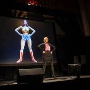 Amy Cuddy showing a Power Pose during her 2012 TED Global presentation.