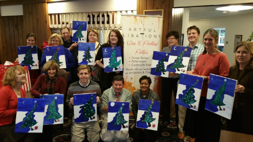 Mortgage Network paints whimsical trees for their holiday party.